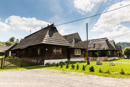 PODBIEL, SLOVAKIA - AUGUST 2, 2016: View of rural houses in the small town Podbiel on August 2, 2016. Its located in the north Slovakian region Orava and popular by tourist for its heritage houses.
