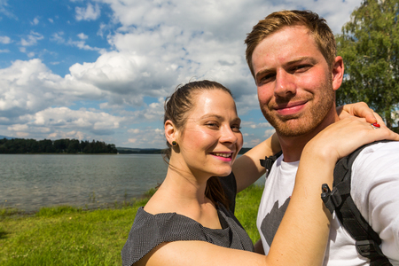 View of a couple at the Orava Barrier Lake in Slovakia