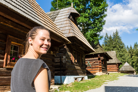 View of a girl in the historical ancient museum village Zuberec Brestova in Slovakia