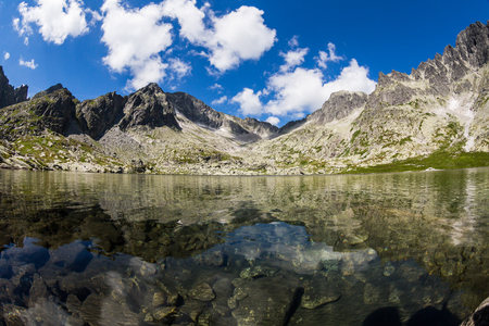 plies: Mountain lake at the end of the hiking route to the Teryho Chata in the High Tatras in Slovakia Stock Photo