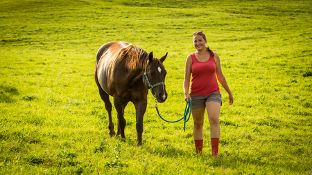 View of a girl with a horse on a field in Slovakian region Orava Stock Photo