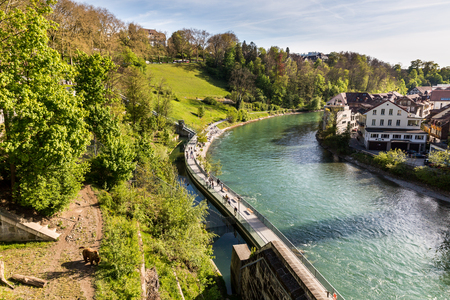 BERN, SWITZERLAND - APRIL 30, 2017: View of the Bear Pit ( Barengraben ) a tourist attraction in the Swiss capital city of Bern on April 30, 2017. Its situated at the eastern edge of Bern. Editorial