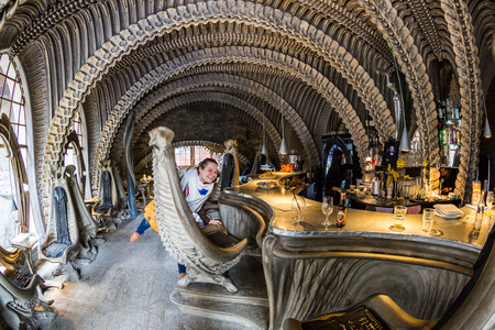 terrifying: GRUYERES, SWITZERLAND - MAY 1, 2017: View of the interior of the HR Giger Bar in the small Castle Village of Gruyeres on May 1, 2017. This artist was famous for blockbuster movies such as Alien.