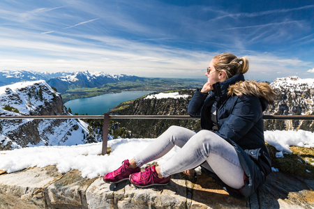 Girl at the Niederhorn Beatenberg Mountain summit with the Bernese Alps in background