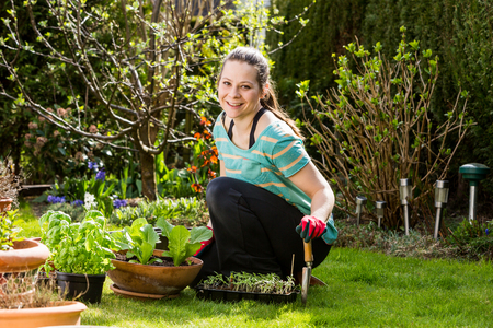 View of a girl gardening in the backyard Stock Photo