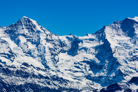 View of the mountains Eiger Moench and Jungfrau in the Bernese Alps in Switzerland