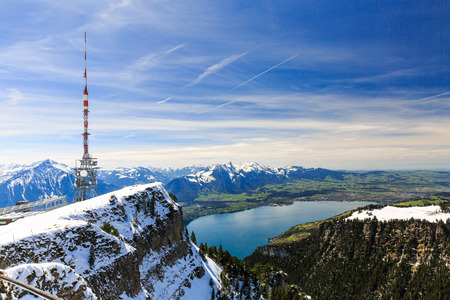 View of the Niederhorn mountain peak in the Bernese Alps above the Lake Thun in springtime