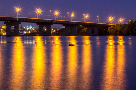dniper: Night bridge lights reflected in river water. HDR