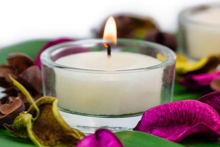 potpourri: Composition of burning candles fragrant potpourri on monstera leaf