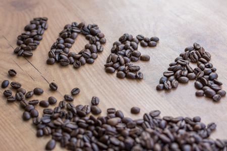 conceptional: Idea concept sign drawn among brown well roasted coffee beans Stock Photo