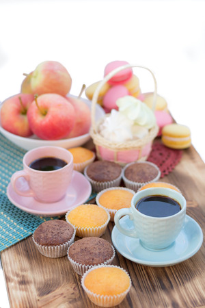 teacake: Still life of served coffee cups, macaroon cookies, marshmallows and apples