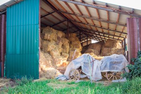 haymow: Hay stacks and bales at farm haylof hangar storage