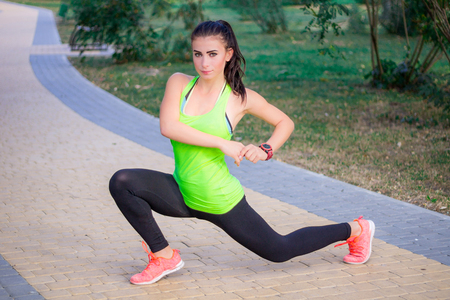 lunge: Young fitness girl does lunge exercises during training workout outdoor