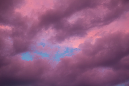 gloaming: Colourful skyscape with versicolored purple clouds at sunset dusk