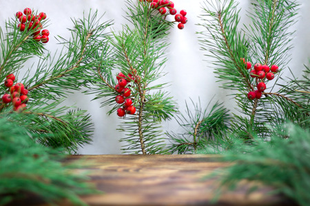 eberesche: Christmas and New Year seasonal wooden background with pine tree branches and red rowan berries, copy space