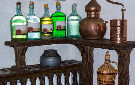 Ukrainian Russian home made moonshine vodka spirit on rural country style kitchen with village interior decoration accessories Standard-Bild