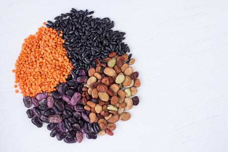 Healthy organic vegan vegetarian grain food cereal bean lentils ingredients mixture circle with copy-space