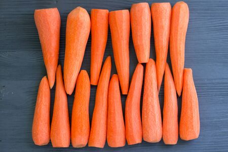 Fresh cleared yellow orange red carrot vegetables for cooking healthy organic vegan food recipe