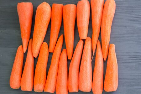 Fresh cleared orange red carrot vegetables prepared for cooking healthy organic vegan food recipe