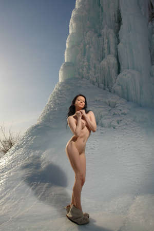 nude outdoors: Naked girl on a glacier