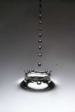 The drop, which falls into the water Stock Photo - 13361017