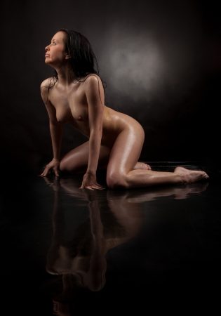 girl in water on a black background photo