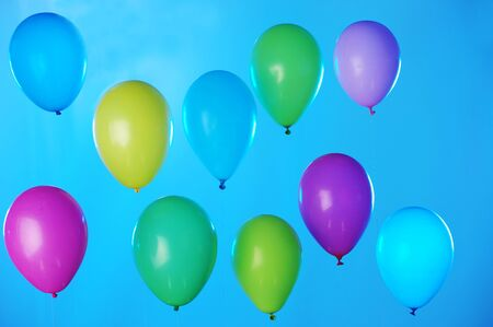 Colorful balloons arranged in two rows on dark blue sky