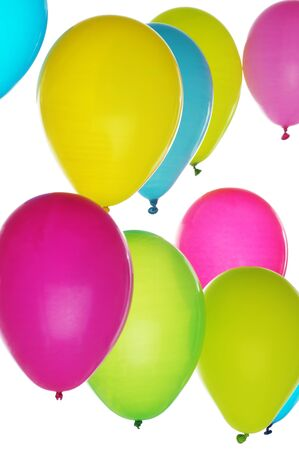 Colorful balloons in bunch on light background; vertical orientation