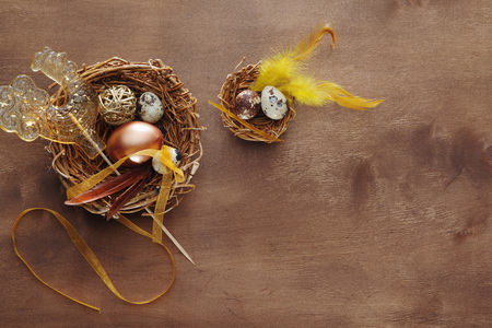 Easter eggs and decorative ornaments on a wooden background. Template for postcard, congratulations, banner, site, cover, brochure. Stock Photo