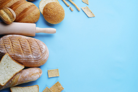 Decorative Display Of Wheat Baking And Kitchen Accessories On A Light Blue  Background, Top View