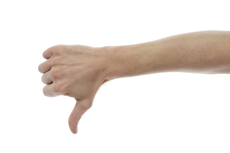 Male hand with a lowered thumb showing dislike, on a white isolated background.
