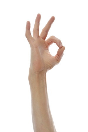 Male hand shows ok sign on a white background. 스톡 콘텐츠
