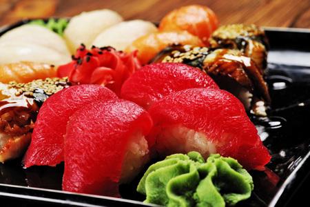 Appetizing tuna sushi with wasabi sauce close-up.
