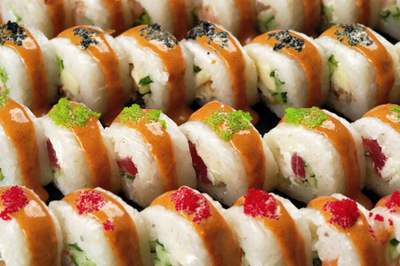A variety of delicious sushi on a dish close-up. 스톡 콘텐츠