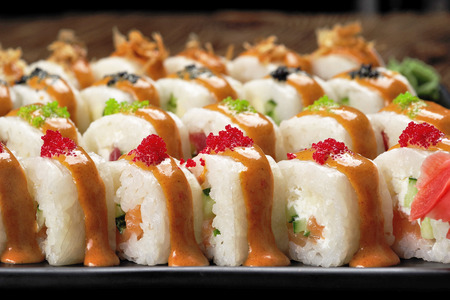 A variety of delicious sushi on a dish close-up.
