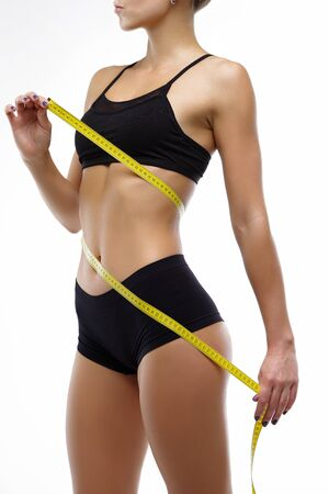 Striving to lose weight a healthy lifestyle slimness. Beautiful figure youth in a healthy body 스톡 콘텐츠