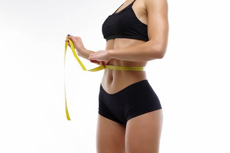 Striving to lose weight a healthy lifestyle slimness. Beautiful figure youth in a healthy body Stock Photo
