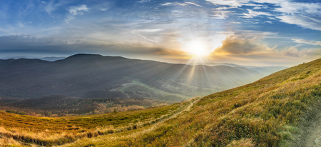 Sunset in the autumn in the mountains. Bieszczady National Park - Cary?ska meadow - Poland.