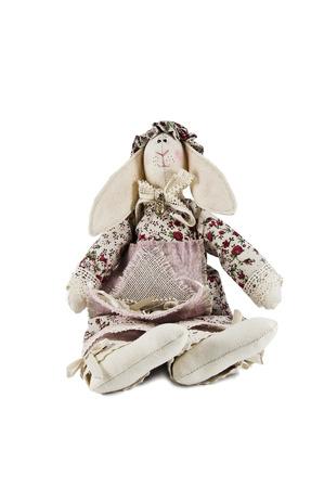 stuffed soft sitting toy hare isolated against white background photo