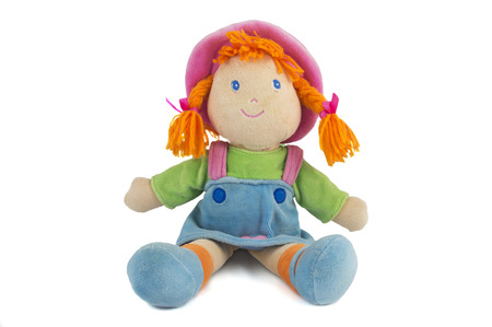 cuddly baby: stuffed soft sitting funny pig-tailed red-headed doll isolated over white