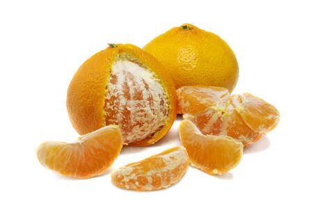 lith: close up of fresh orange mandarine and wedges isolated over white