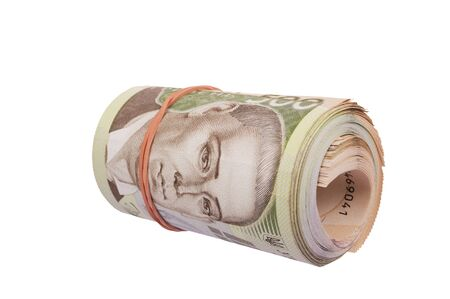 hryvna: roll of ukrainian hryvna bills isolated over white