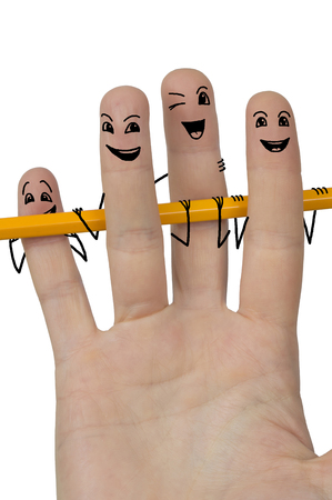 woman hand holding pencil. funny stickmen supporting pencil drawn on fingers. Studio shot isolated over white Stock Photo