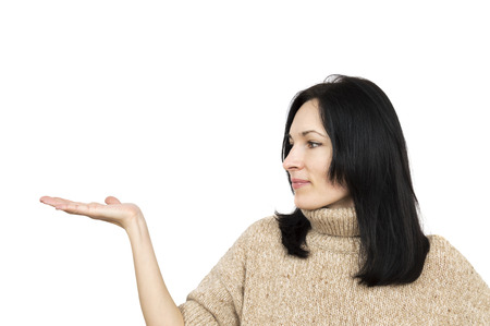 pull over: woman wearing beige sweater holding arm palm up isolated over white