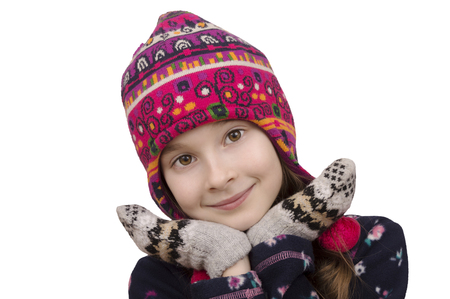 young posing girl in winter hat and mittens isolated over white