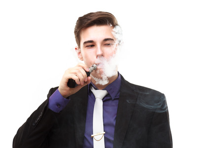 steam mouth: Portrait of a man in suit smoking an e-cigarette isolated on white. Let the steam out of his mouth Stock Photo