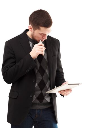 background e cigarette: Vaping casual businessman using his tablet isolated on white Stock Photo