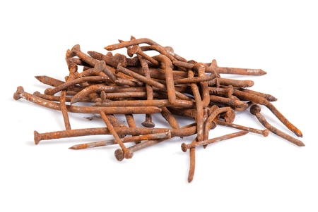 Rusty nails on a white background Stock Photo