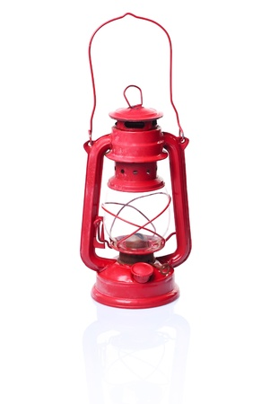 kerosene lamp: Red oil lamp on a white background with reflection