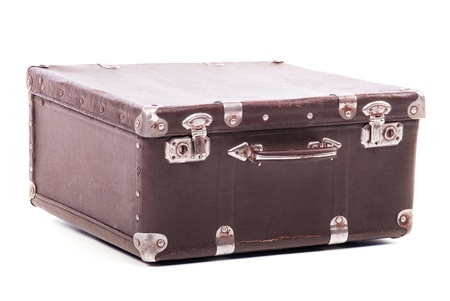 Old leather suitcase isolated on white background photo